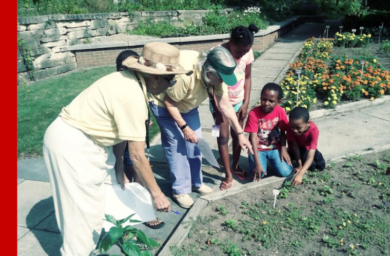 Children planting at Applewood Estate