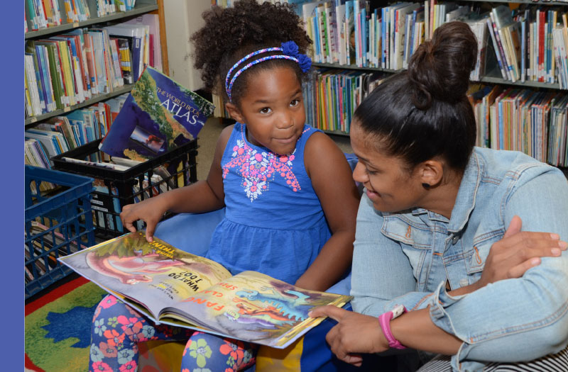 Young Girl reading at the Flint Public Library