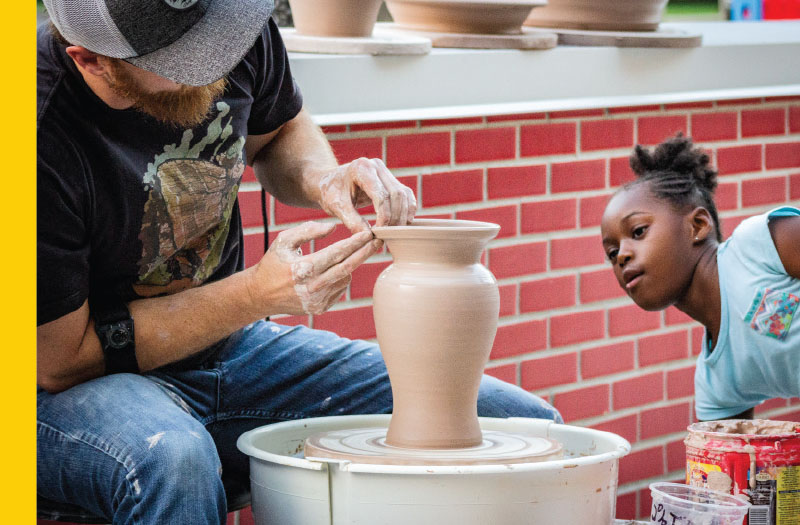Young girl learning about ceramics at the Flint Institute of Arts